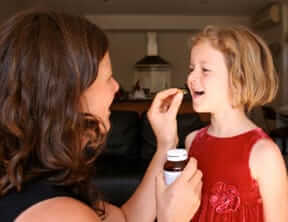 Mom Giving Daughter Supplement