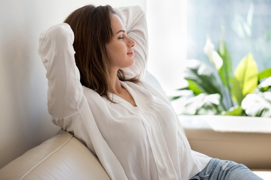 woman breathing in and relaxing