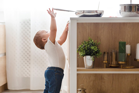 toddler reaching up