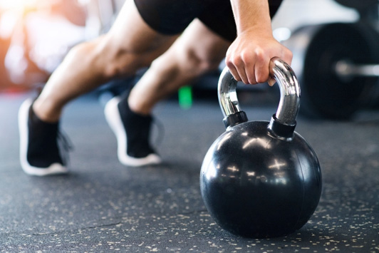 person using kettle bell weight