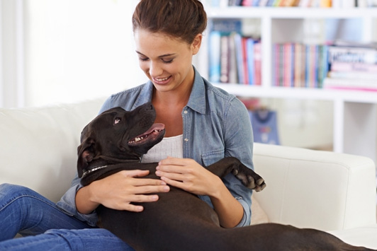 woman holding dog in arms