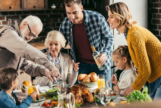 family having dinner during holidays
