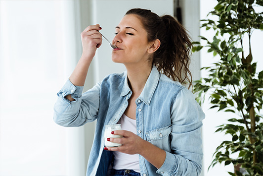 Woman Gets Probiotics From Eating Yogurt