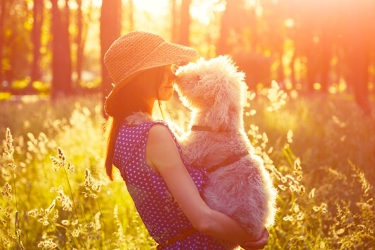 woman-embraces-dog