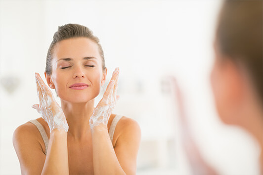 Woman Uses Double Cleansing To Wash Face